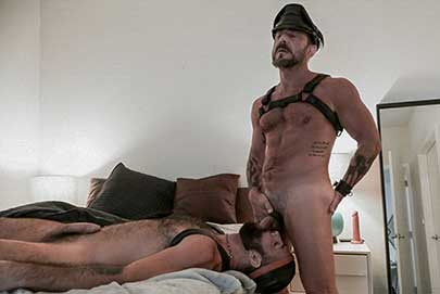 Leathermen Vince Parker and Jake Nicola are ready for some playtime, so the hairy, bearded top straps his bottom's wrists and ankles together so he can spread his cheeks wide and penetrate that hole...