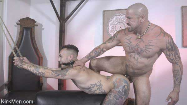 Rocky Maximo makes Matthew Grande his Little Bitch in their first Kink shoot. Blindfolded and bound to the St Andrews cross Matthew Grande squirms and groans as the sadistic Rocky Maximo manhandles his plaything.